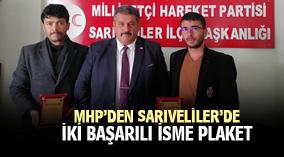 MHP'den Sarıveliler'de iki başarılı isme plaket