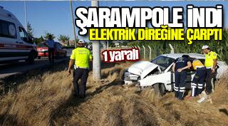 Şarampole inen otomobil elektrik direğine çarptı